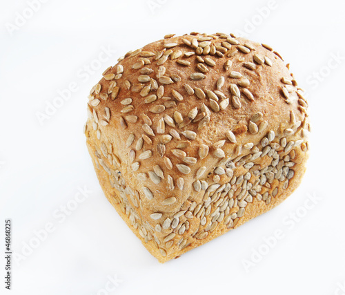 Small loaf dusted with seeds of sunflower
