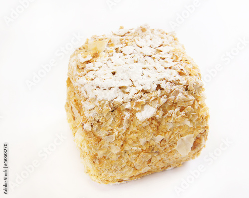 Square cake covered with sugar powder
