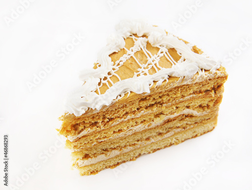 Triangular cake with cream ornament