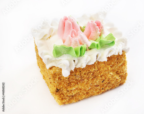 Square cake covered with cream