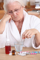 Elderly lady sat with her medication