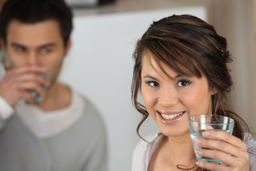 Couple drinking glass of water