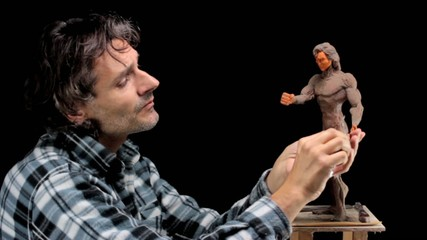 artist at work on human muscular miniature
