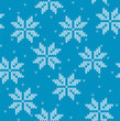 Snowflakes on knitted background