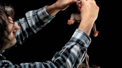 artist at work on human muscular miniature