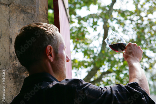 Man examining a glass of wine