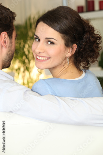 woman sitting on sofa with boyfriend
