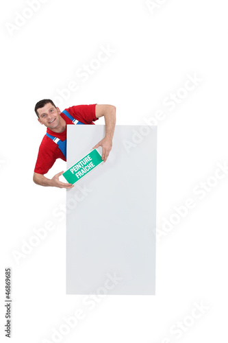 Man stood with wet paint sign