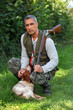 Hunter with shotgun and spaniel