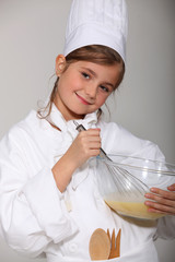 portrait of a little girl in baker clothes