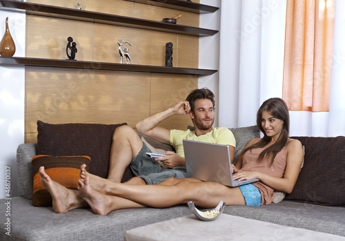 Young couple having rest in living room