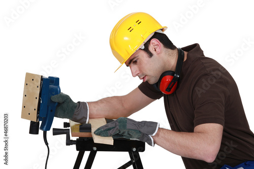 Man with an electrical sander
