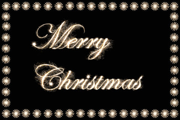 """""""Merry Christmas"""" text by sparkler style with freeze light."""