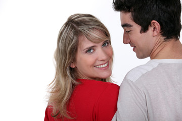Young man and pretty young woman with bright smile