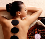 woman having stone massage in spa salon