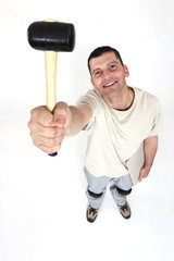 Handyman holding a mallet in the air