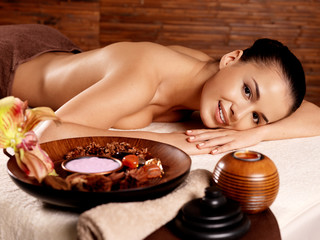 woman after massage in spa salon