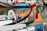 Portuguese sailor mooring traditional moliceiro boat in Aveiro, poster