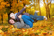 happy dad and son in a yellow autumn park