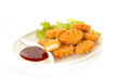Plate of nuggets with dip sauce, one nugget cut - 46873648