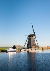 Dutch windmill on the river banks