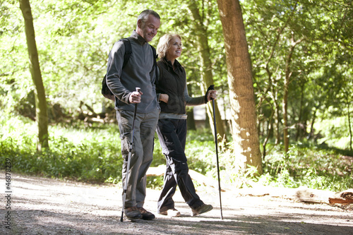 A mature couple walking in the countryside