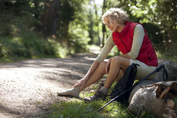 A woman hiker massaging her sore feet