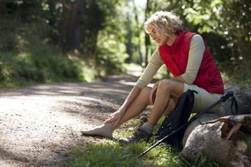 A woman hiker massaging her sore feet