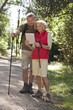 A mature couple out walking navigating with an ipad