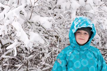 Boy in a snowy forest