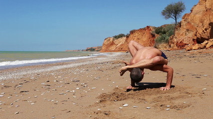Yoga Power Push-Up Exercise on the wild Beach
