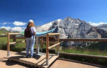 hiker looks Marmolada mount