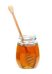 jar of honey with dipper