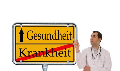 Arzt zeigt auf Schild - Gesundheit