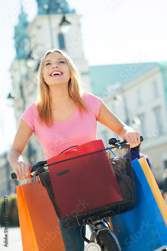 Woman on bike with shopping bags