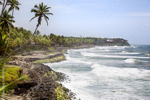 waves toward the cliffs of varkala