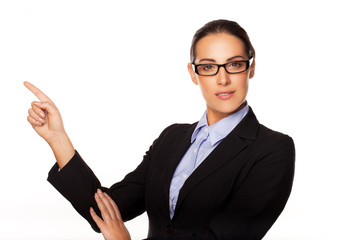 Confident business executive pointing