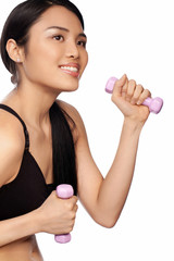 Beautiful Asian woman exercising with dumbbells