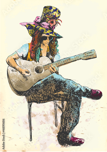 Guitar player - Eccentric with a colored hat. - 46890686