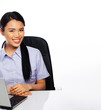 Smiling Asian businesswoman at her desk