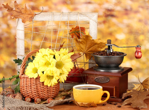 autumnal composition:coffee grinder, flowers  and leaves