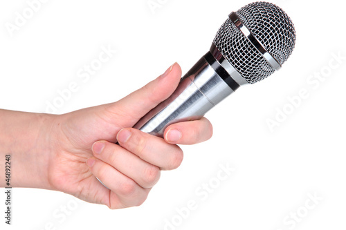 Silver microphone in hand isolated on white