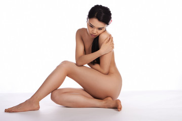 Beautiful Asian woman posing naked