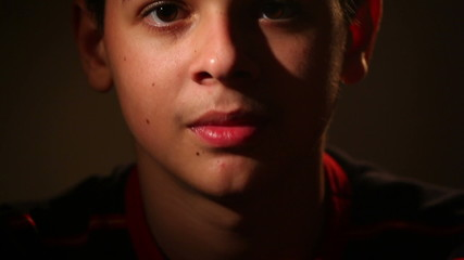portrait of a teenager on a dark background