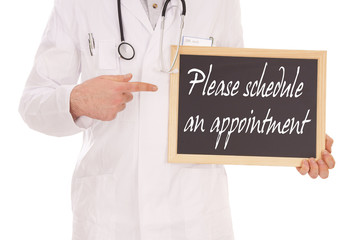 Doctor with a sign - Please schedule an appointment