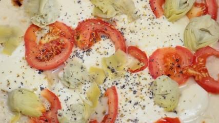 Italian Piadina with cheese , artichoke and tomato