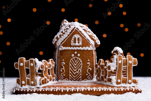 Gingerbread cookie house on dark background