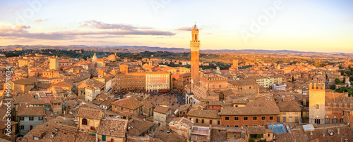 Siena sunset panoramic skyline. Mangia tower landmark. Tuscany,