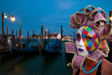 Venice, Italy - Carnival. Gondolas  in background