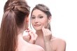 Sensual woman touching her face watching in mirror